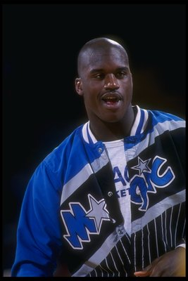 1992-1993:  Center Shaquille O''Neal of the Orlando Magic looks on during a game against the Denver Nuggets at McNichols Arena in Denver, Colorado. Mandatory Credit: Tim DeFrisco  /Allsport Mandatory Credit: Tim DeFrisco  /Allsport