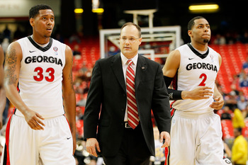 ATLANTA, GA - MARCH 10:  Head coach Mark Fox of the Georgia Bulldogs walks with Trey Thompkins #33 and Marcus Thornton #2 during their game against the Auburn Tigers during the first round of the SEC Men's Basketball Tournament at the Georgia Dome on Marc