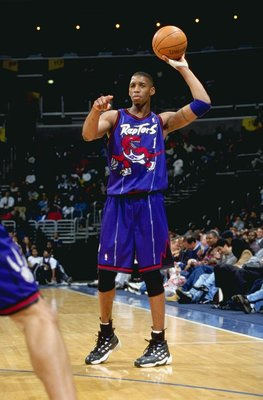 21 Apr 1999: Tracy McGrady #1 of the Toronto Raptors points as he's ready to pass the ball during the game against the Washington Wizards at the MCI Center in Washington, D.C. The Raptors defeated the Wizards 107-91.