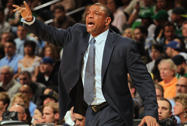 DENVER, CO - FEBRUARY 24:  Head coach Doc Rivers of the Boston Celtics leads his team against the Denver Nuggets during NBA action at the Pepsi Center on February 24, 2011 in Denver, Colorado. The Nuggets defeated the Celtics 89-75. NOTE TO USER: User exp