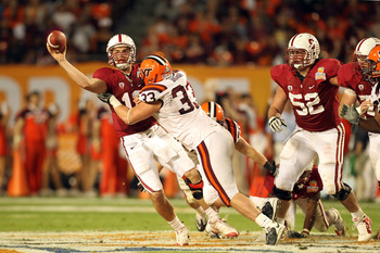 MIAMI, FL - JANUARY 03:  Andrew Luck #12 of the Stanford Cardinal throws a pass under pressure from Chris Drager #33 of the Virginia Tech Hokies during the 2011 Discover Orange Bowl at Sun Life Stadium on January 3, 2011 in Miami, Florida. Stanford won 40