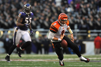 BALTIMORE, MD - JANUARY 2:  Carson Palmer #9 of the Cincinnati Bengals fumbles the ball with less than two  minutes to go in the game against the Baltimore Ravens at M&T Bank Stadium on January 2, 2011 in Baltimore, Maryland. The Ravens defeated the Benga