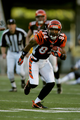 CINCINNATI - OCTOBER 1:  Wide receiver  T.J. Houshmandzadeh #84 of the Cincinnati Bengals carries the ball against the New England Patriots during the NFL game on October 1, 2006 at Paul Brown Stadium in Cincinnati, Ohio. The Patriots won 38-13. (Photo by