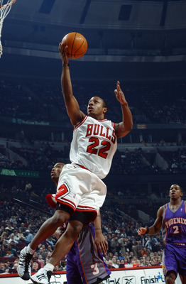CHICAGO - FEBRUARY 24:  Jay Williams #22 of the Chicago Bulls goes up for a layup against the Phoenix Suns during the game at United Center on February 24, 2003 in Chicago, Illinois.  The Bulls won 90-87.  NOTE TO USER: User expressly acknowledges and agr