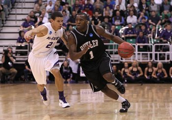 SALT LAKE CITY - MARCH 27:  Shelvin Mack #1 of the Butler Bulldogs drives the ball past Denis Clemente #21 of the Kansas State Wildcats during the west regional final of the 2010 NCAA men's basketball tournament at the Energy Solutions Arena on March 27,