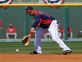 GOODYEAR, AZ - FEBRUARY 27:  Orlando Cabrera #20 of the Cleveland Indians fields a ground ball against the Cincinnati Reds at Goodyear Ballpark on February 27, 2011 in Goodyear, Arizona.  (Photo by Norm Hall/Getty Images)