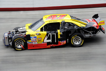 Ambrose drives a banged up car after a wreck ended a top-10 run.