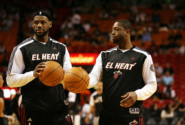 MIAMI - MARCH 14:  Forward LeBron James #6 and guard Dwyane Wade #3 of the Miami Heat  against the San Antonio Spurs at American Airlines Arena on March 14, 2011 in Miami, Florida. NOTE TO USER: User expressly acknowledges and agrees that, by downloading