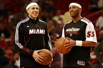 MIAMI - MARCH 12:  Guard Mike Bibby #0 of the Miami Heat (L) chats with teamate Eddie House #55  against the Memphis Grizzlie at American Airlines Arena on March 12, 2011 in Miami, Florida. NOTE TO USER: User expressly acknowledges and agrees that, by dow