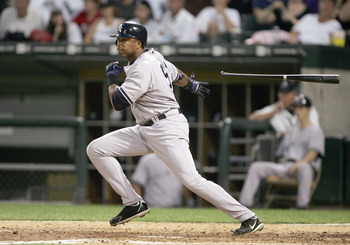 CHICAGO - AUGUST 9:  Bernie Williams #51 of the New York Yankees tosses the bat during the game against the Chicago White Sox on August 9, 2006 at U.S. Cellular Field in Chicago, Illinois. (Photo by Jonathan Daniel/Getty Images)