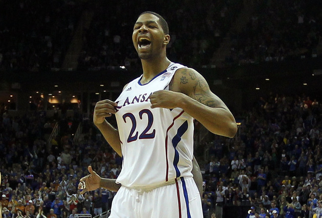 KANSAS CITY, MO - MARCH 12:  Marcus Morris #22 of the Kansas Jayhawks reacts to a play against the Texas Longhorns in the second half of the 2011 Phillips 66 Big 12 Men's Basketball Tournament championship game against the Kansas Jayhawks at Sprint Center