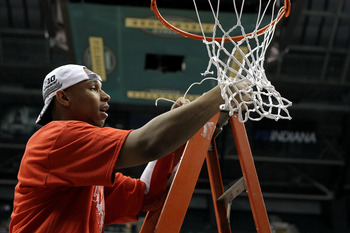 INDIANAPOLIS, IN - MARCH 13:  Jared Sullinger #0 of the Ohio State Buckeyes cuts down a piece of the net in celebration of their 71-60 win against the Penn State Nittany Lions during the championship game of the 2011 Big Ten Men's Basketball Tournament at