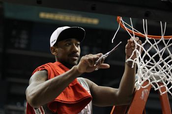 INDIANAPOLIS, IN - MARCH 13:  David Lighty #23 of the Ohio State Buckeyes cuts down a piece of the net in celebration of their 71-60 win against the Penn State Nittany Lions during the championship game of the 2011 Big Ten Men's Basketball Tournament at C