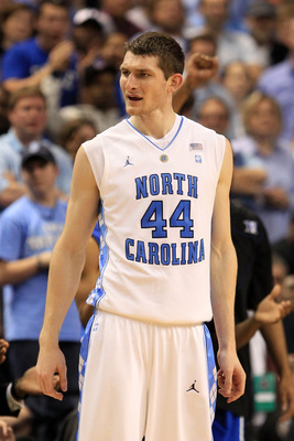 GREENSBORO, NC - MARCH 13:  Tyler Zeller #44 of the North Carolina Tar Heels looks on while playing against the Duke Blue Devils during the second half in the championship game of the 2011 ACC men's basketball tournament at the Greensboro Coliseum on Marc