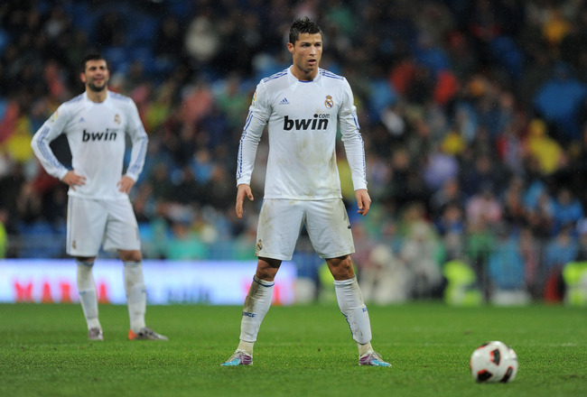 MADRID, SPAIN - FEBRUARY 19:  Cristiano Ronaldo of Real Madrid gets ready to take a direct free kick during the La Liga match between Real Madrid and Levante at Estadio Santiago Bernabeu on February 19, 2011 in Madrid, Spain.  (Photo by Denis Doyle/Getty