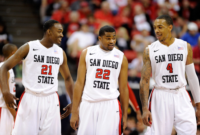 LAS VEGAS, NV - MARCH 10:  Jamaal Franklin #21, Chase Tapley #22 and Malcolm Thomas #4 of the San Diego State Aztecs share a laugh during a quarterfinal game of the Conoco Mountain West Conference Basketball tournament against the Utah Utes at the Thomas