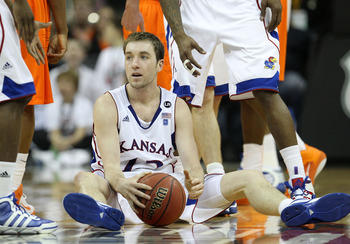 KANSAS CITY, MO - MARCH 10:  Brady Morningstar #12 of the Kansas Jayhawks sits on the court after being called for a foul on the Oklahoma State Cowboys during their quarterfinal game in the 2011 Phillips 66 Big 12 Men's Basketball Tournament at Sprint Cen