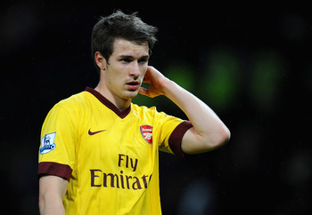 MANCHESTER, ENGLAND - MARCH 12:  Aaron Ramsey of Arsenal looks dejected after defeat in the FA Cup sponsored by E.On Sixth Round match between Manchester United and Arsenal at Old Trafford on March 12, 2011 in Manchester, England.  (Photo by Clive Mason/G