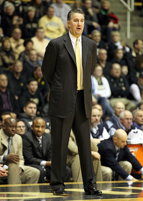 WEST LAFAYETTE, IN - JANUARY 09:  Matt Painter the Head Coach of the Purdue Boilermakers gives instructions to his team during the Big Ten Conference game against the Iowa Hawkeyes at Mackey Arena on January 9, 2011 in West Lafayette, Indiana.  Purdue won