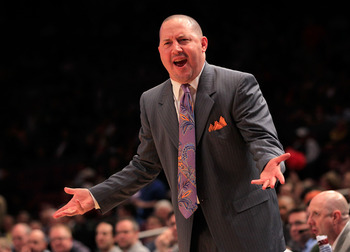 NEW YORK, NY - MARCH 10: head coach Buzz Williams of the Marquette Golden Eagles gestures from the bench during the game against the Louisville Cardinals during the quarterfinals of the 2011 Big East Men's Basketball Tournament presented by American Eagle