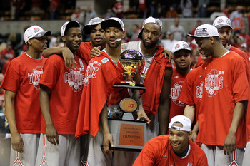 INDIANAPOLIS, IN - MARCH 13:  David Lighty (holding trophy) #23 and Jared Sullinger #0 (squating with tournament MVP trophy) of the Ohio State Buckeyes celebrate along with their teammates with the Big Ten CHampionship trophy after they won 71-60 against