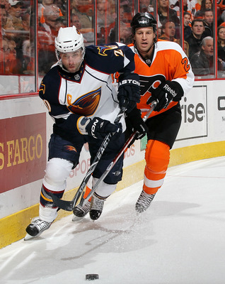 PHILADELPHIA, PA - MARCH 12: Radek Dvorak #20 of the Atlanta Thrashers controls the puck against Nick Boynton #24 of the Philadelphia Flyers on March 12, 2011 at Wells Fargo Center in Philadelphia, Pennsylvania.  (Photo by Jim McIsaac/Getty Images)
