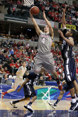 INDIANAPOLIS, IN - MARCH 13:  Aaron Craft #4 of the Ohio State Buckeyes drives for a shot attempt against the Penn State Nittany Lions during the championship game of the 2011 Big Ten Men's Basketball Tournament at Conseco Fieldhouse on March 13, 2011 in