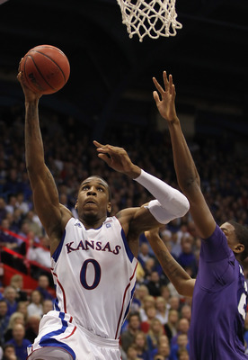 LAWRENCE, KS - JANUARY 29:  Thomas Robinson #0 of the Kansas Jayhawks shoots during the game against the Kansas State Wildcats on January 29, 2011 at Allen Fieldhouse in Lawrence, Kansas.  (Photo by Jamie Squire/Getty Images)