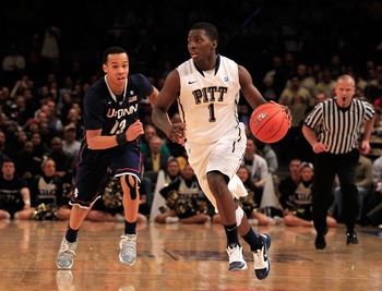 NEW YORK, NY - MARCH 10: Travon Woodall #1 of the Pittsburgh Panthers dribbles past Shabazz Napier #13 of the Connecticut Huskies during the quarterfinals of the 2011 Big East Men's Basketball Tournament presented by American Eagle Outfitters  at Madison
