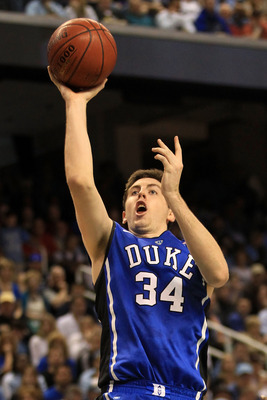 GREENSBORO, NC - MARCH 13:  Ryan Kelly #34 of the Duke Blue Devils shoots against the North Carolina Tar Heels during the first half in the championship game of the 2011 ACC men's basketball tournament at the Greensboro Coliseum on March 13, 2011 in Green