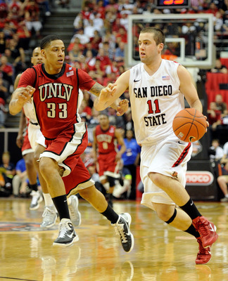 LAS VEGAS, NV - MARCH 11:  James Rahon #11 of the San Diego State Aztecs drives against Tre'Von Willis #33 of the UNLV Rebels during a semifinal game of the Conoco Mountain West Conference Basketball tournament at the Thomas & Mack Center March 11, 2011 i