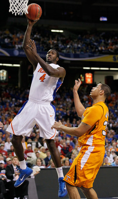 ATLANTA, GA - MARCH 11:  Patric Young #4 of the Florida Gators shoots infront of Brian Williams #33 of the Tennessee Volunteers during the quarterfinals of the SEC Men's Basketball Tournament at Georgia Dome on March 11, 2011 in Atlanta, Georgia.  (Photo