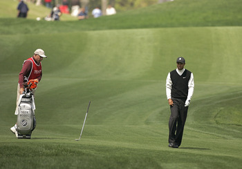 UNITED STATES - MARCH 24:  Tiger Woods reacts by throwing his club after hitting on the fifth fairway during the second round for THE PLAYERS Championship held at the TPC Stadium Course in Ponte Vedra Beach, Florida on March 24, 2006.  (Photo by Michael C