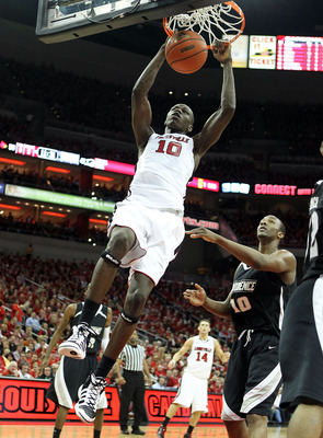 LOUISVILLE, KY - MARCH 02:  Gorgui Dieng #10 of the Louisville Cardinals dunks the ball during the Big East Conference game against the Providence Friars at the KFC Yum! Center on March 2, 2011 in Louisville, Kentucky. Louisville won 87-60.  (Photo by And