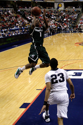INDIANAPOLIS, IN - MARCH 12:  Kalin Lucas #1 of the Michigan State Spartans attempts a shot against Tim Frazier #23 of the Penn State Nittany Lions  during the semifinals of the 2011 Big Ten Men's Basketball Tournament at Conseco Fieldhouse on March 12, 2