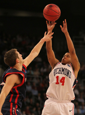 PROVIDENCE, RI - MARCH 18: Kevin Anderson #14 of the Richmond Spiders shoots a basket against the Saint Mary's Gaels during the first round of the 2010 NCAA men's tournament at Dunkin' Donuts Center on March 18, 2010 in Providence, Rhode Island. (Jim Roga
