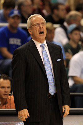 GREENSBORO, NC - MARCH 12:  Head coach Roy Williams of the North Carolina Tar Heels reacts while playing the Clemson Tigers in the semifinals of the 2011 ACC men's basketball tournament at the Greensboro Coliseum on March 12, 2011 in Greensboro, North Car