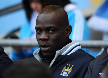 MANCHESTER, ENGLAND - MARCH 13:  Mario Balotelli of Manchester City sits on the bench ahead of the FA Cup sponsored by E.On Sixth Round match between Manchester City and Reading at the City of Manchester Stadium on March 13, 2011 in Manchester, England.