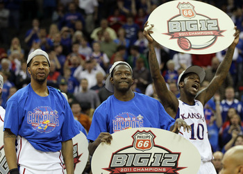 KANSAS CITY, MO - MARCH 12:  Markieff Morris #21, Elijah Johnson #15 and Tyshawn Taylor #10 of the Kansas Jayhawks celebrate after defeating the Texas Longhorns 85-73 to win the 2011 Phillips 66 Big 12 Men's Basketball Tournament championship game at Spri