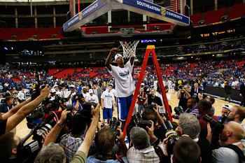 ATLANTA - MARCH 13: Deandre Liggins #34 of the Kentucky Wildcats cuts down the net after their 70 to 54 win over the Florida Gators in the championship game of the SEC Men's Basketball Tournament at Georgia Dome on March 13, 2011 in Atlanta, Georgia. (Pho