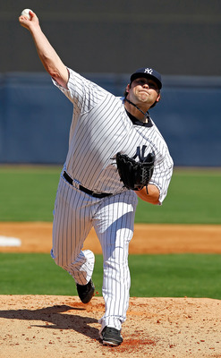 TAMPA, FL - FEBRUARY 26:  Pitcher Joba Chamberlain #62 of the New York Yankees pitches against the Philadelphia Phillies during a Grapefruit League Spring Training Game at George M. Steinbrenner Field on February 26, 2011 in Tampa, Florida.  (Photo by J.