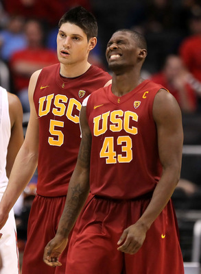 LOS ANGELES, CA - MARCH 11:  Nikola Vucevic #5 and Marcus Simmons #43 of the USC Trojans react late in the second half while taking on the Arizona Wildcats in the semifinals of the 2011 Pacific Life Pac-10 Men's Basketball Tournament at Staples Center on