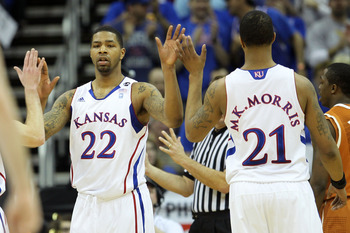 KANSAS CITY, MO - MARCH 12:  Marcus Morris #22 and Markieff Morris #21 of the Kansas Jayhawks react after a play against the Texas Longhorns during the 2011 Phillips 66 Big 12 Men's Basketball Tournament championship game at Sprint Center on March 12, 201