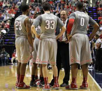 INDIANAPOLIS, IN - MARCH 13:  Head coach Thad Matta of the Ohio State Buckeyes talks with his players during a timeout including David Lighty #23, Jon Diebler #33 and Jared Sullinger #0 against the Penn State Nittany Lions during the championship game of
