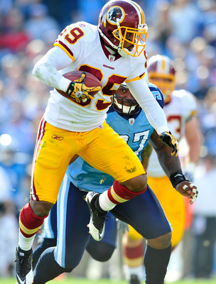 NASHVILLE, TN - NOVEMBER 21:  Santana Moss #89 of the Washington Redskins makes a catch under pressure from Tony Brown #97 of the Tennessee Titans during the first half at LP Field on November 21, 2010 in Nashville, Tennessee.  (Photo by Grant Halverson/G