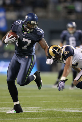 SEATTLE, WA - JANUARY 02:  Wide receiver Mike Williams #17 of the Seattle Seahawks runs with the ball after a catch against the St. Louis Rams during their game at Qwest Field on January 2, 2011 in Seattle, Washington.  (Photo by Otto Greule Jr/Getty Imag