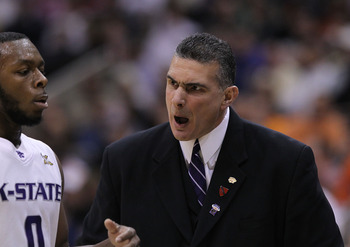 SALT LAKE CITY - MARCH 25:  Head coach Frank Martin of the Kansas State Wildcats yells at Jacob Pullen #0 against the Xavier Musketeers during the third round of the 2010 NCAA men�s basketball tournament at the Energy Solutions Arena on March 25, 2010 in