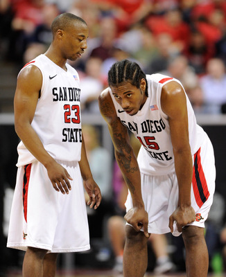 LAS VEGAS, NV - MARCH 11:  D.J. Gay #23 of the San Diego State Aztecs talks to teammate Kawhi Leonard #15 during a semifinal game of the Conoco Mountain West Conference Basketball tournament at the Thomas & Mack Center March 11, 2011 in Las Vegas, Nevada.