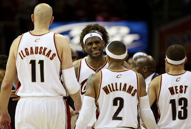 CLEVELAND - MAY 20:  LeBron James #23 reacts after a play with teammates Zydrunas Ilgauskas #11, Mo Williams #2 and Delonte West #13 of the Cleveland Cavaliers against the Orlando Magic in Game One of the Eastern Conference Finals during the 2009 Playoffs