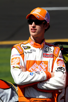 DAYTONA BEACH, FL - FEBRUARY 13:  Joey Logano, driver of the #20 Home Depot Toyota, looks on during qualifying for the NASCAR Sprint Cup Series Daytona 500 at Daytona International Speedway on February 13, 2011 in Daytona Beach, Florida.  (Photo by Jerry